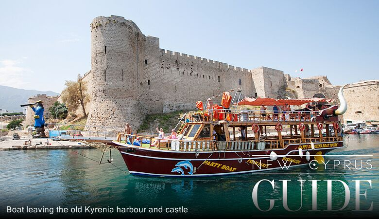 Boat leaving the old Kyrenia harbour and castle